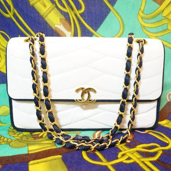 80s rare vintage Chanel white purse with navy rope string and gold chain. Very rare piece from the era.