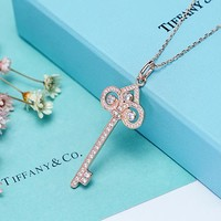 Tiffany & Co. Heart crown micro-set key lock necklace