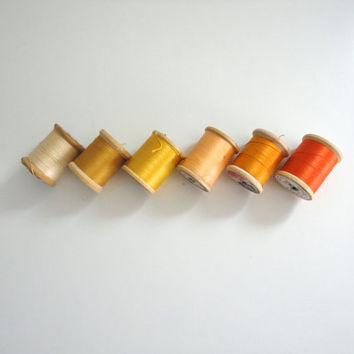 Vintage sewing thread lot of 6 wooden spools in fall colors, hues of cream, yellow, orange and gold