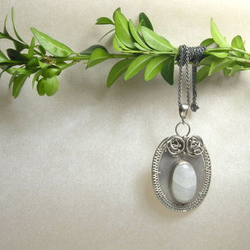 Silver wire wrapped pendant with moonstone by MadeBySunflower