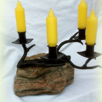 Rock base with forged twig candle holder