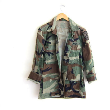 Vintage men's army shirt. military jacket. distressed camouflage coat with patches