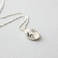 Sterling silver music necklace.  Treble clef under glass in small stering setting with chain.  Dainty and feminine