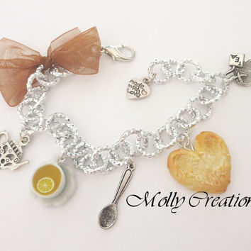 Tea Time bracelet with polymer clay cookie or slice cake and cup of the