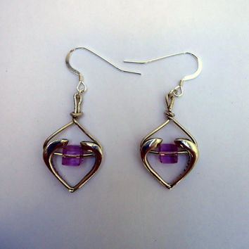 Sterling silver open heart earrings with pale lilac square swarovski crystal and french ear wires.