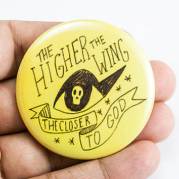 the higher the wing, the closer to god | 2.25 inch pin back button