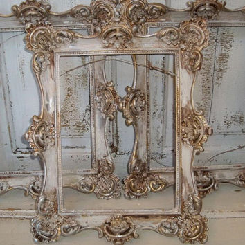 Picture frame grouping white distressed French provincial frames silvery antique gold finish Anita Spero
