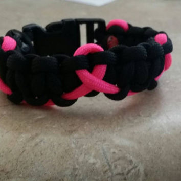 Survivors Series Breast Cancer Awareness Paracord Bracelet. Show your support with this Breast Cancer Awareness Paracord Bracelet.
