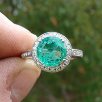 Emerald in a 14 Kt White Gold and Diamond Semi Mount Ring