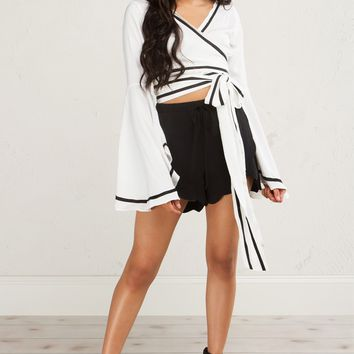AKIRA BLACK AND WHITE DEEP V BELL SLEEVE WRAP AROUND CROP TOP