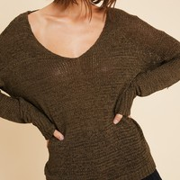 Giving Back Sweater