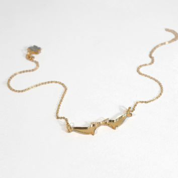 Gold Mirror Dueling Narwhal Necklace
