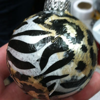 Set of 4 Zebra and cheetah Christmas ornaments.
