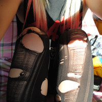 Hipster style ripped black tights