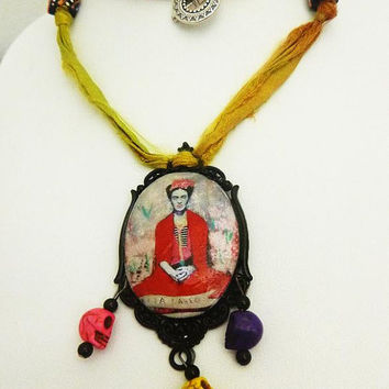 Frida Kahlo clay tile cab pendant on Sari silk ribbon with Skull beads