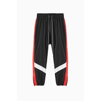 parachute track pant ii / black + red + ivory