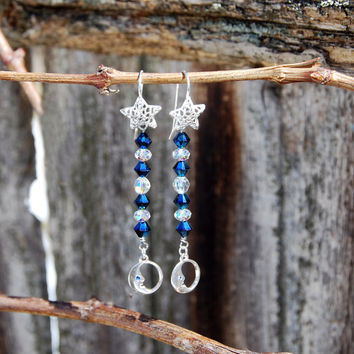 Handmade Sterling Silver Moon and Swarovski earrings. Blue Swarovski Metallic crystals, sterling silver moon charm, silver star ear wires