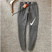 NIKE New Fashion Big Hook Print Sports Leisure Couple Sports Leisure Pants Dark gray