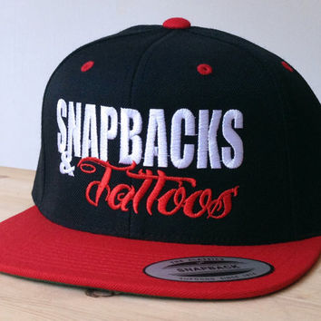 SnapBacks and Tattoos Cap with Custom Embroidered Logo.  Made to order quality snap back hats and designs