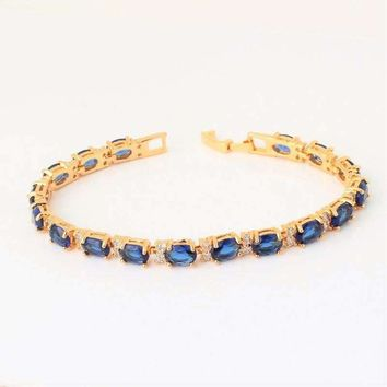 Sapphire Blue Oval Austrian Crystal Tennis Bracelet with Extender in Yellow Gold