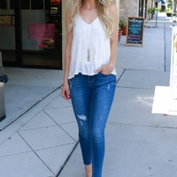 Lightly Distressed High Waisted Skinny Jeans Medium Denim