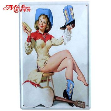 Cowgirl pinup tin sign