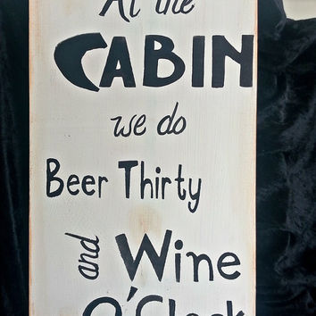 Wood sign, cabin, wine, beer drinking
