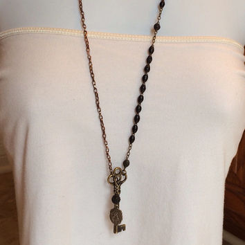 Brass Antique Skeleton Key with Religious Medal on old Rosary Beads