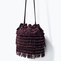 Studded fringed bucket bag