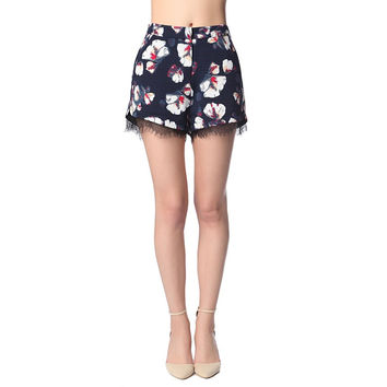 Navy blue shorts in floral print with lace detail
