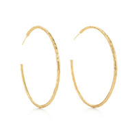 Tiffany & Co. - Paloma Picasso® Hammered hoop earrings in 18k gold, large.