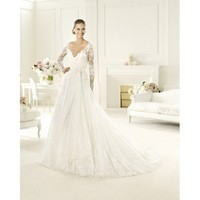 Elegant A-line wedding gown for brides with handmade floral appliqués