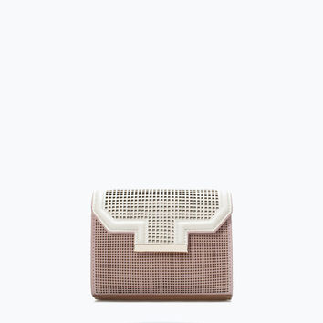Small perforated messenger bag