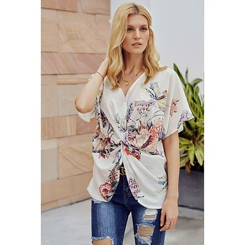 Chic White Amaryllis Floral Twist Top