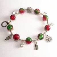 Christmas Bauble Charm Bracelet .. Beaded bracelet with red/green crackle beads, silver beads and bells, and festive charms, magnetic clasp