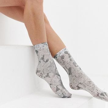 ASOS DESIGN snake socks at asos.com
