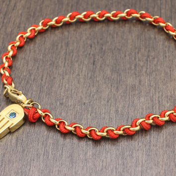 Hamsa bracelet with the string in Blue, Red, White