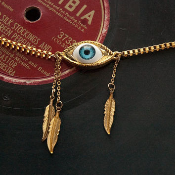 blue eye & three feathers // short gold toned necklace on square venice chain