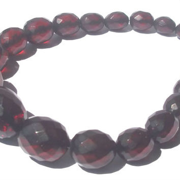 Vintage Cherry Amber bakelite faceted loose oval beads. Nice.