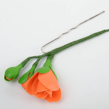 Handmade decorative metal hair pin with cold porcelain flower of orange color