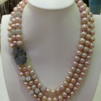 Triple-Strand Pink Freshwater Pearl Necklace With A Large Shell Flower