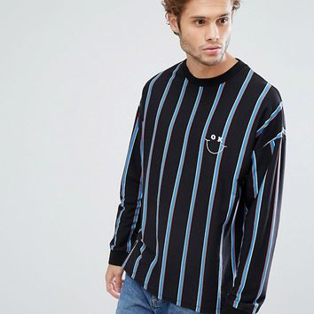 ASOS Oversized Long Sleeve T-Shirt With Vertical Stripe And OK Embroidery at asos.com