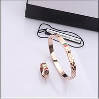 GUCCI :Titanium steel rose gold men and women couple bracelet fashion simple big bracelet lettering accessories