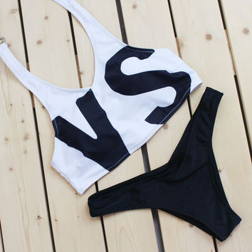 Upper white with VS Alphabet style hanging neck back knot two piece vest bottom black two piece bikini swimsuit