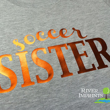 SOCCER SISTER cursive, shiny foil t-shirt with your choice of color-- fitted, regular, or long sleeve