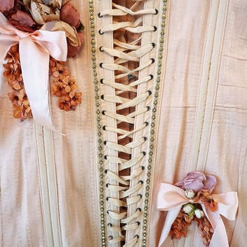 Pink vintage corset wall hanging shabby cottage chic romantic bustier w/ garter peach-pinky embellished millinery flowers anita spero design