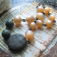 Neutral Territory. Vintage Lucite Necklace Pale Peach and Charcoal