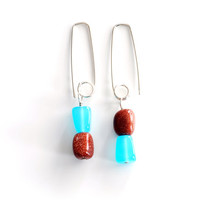 Goldstone and blue quartz nugget drop earrings , sterling silver blue and sparkly orange wire wrapped earrings , long beaded silver earrings