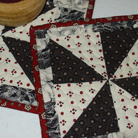 Quilted Mug Rug, Black, Red and White  8 x 9 Pin Wheel design, handmade, hand sewn binding, washable. Great for Mothers Day
