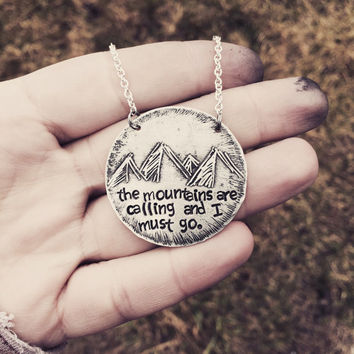 "Unique hand drawn metal etched mountains pendant necklave hand stamped with ""the mountains are calling and i must go"" quote"